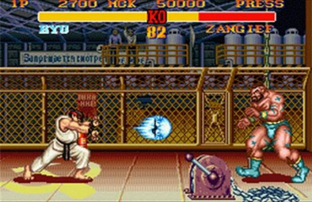 Ryu lance un Hadoken sur Zangief dans Street Fighter II'