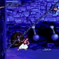 Aladdin dans la prison du palais du sultan et qui évite des boulets