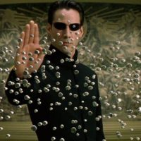Neo arrête les balles avec la main