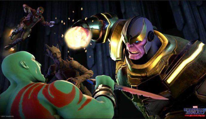 Thanos et Drax le destructeur se battent, avec Star-Lord et Groot en fond