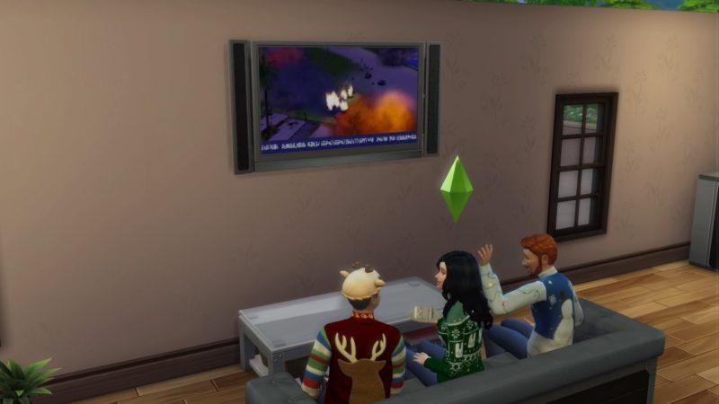 Les Sims 4 famille sur le canapé