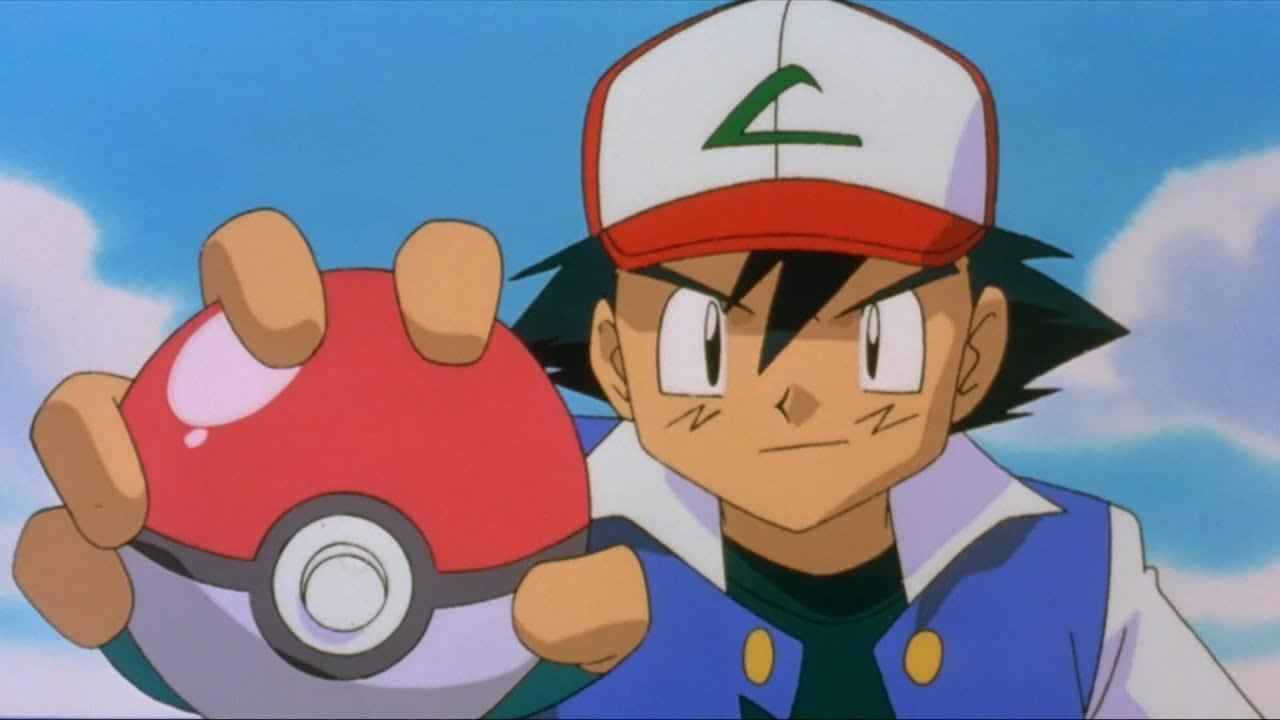Sacha tient une pokéball dans sa main