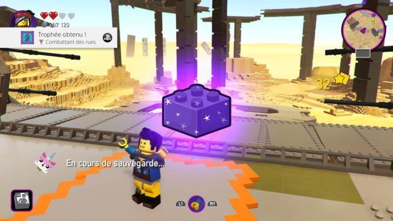 La Grande Aventure LEGO 2 : le jeu vidéo les briques maitres servant à ouvrir les voies à d'autres mondes